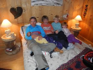 Returning from a ski tour and breastfeeding Olivia in ski gear with my niece and nephews
